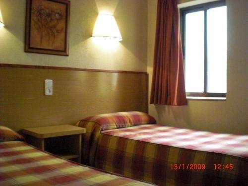 Habitación doble camas individuales Hotel Avenida